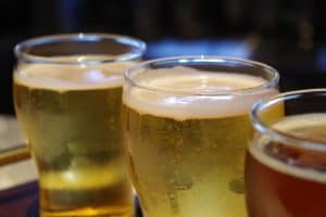 three beer glasses in a row
