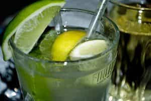 clear cocktail with lime wedge on edge