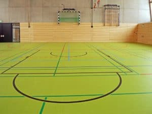 empty gymnasium with lines on the floor