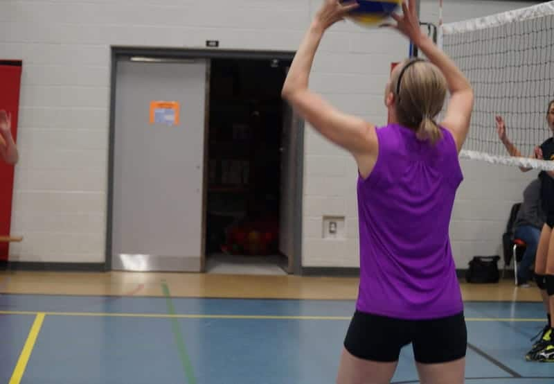 female player setting the volleyball