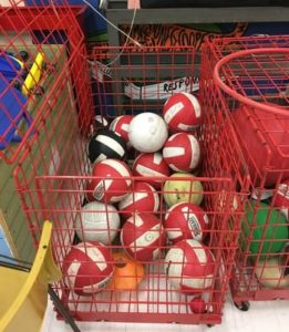 cage full of volleyballs