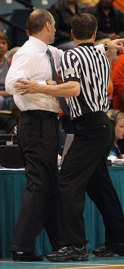 ref holding back coach