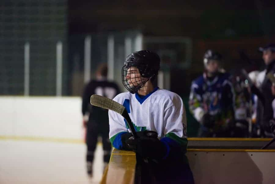 hockey player watching from the bench