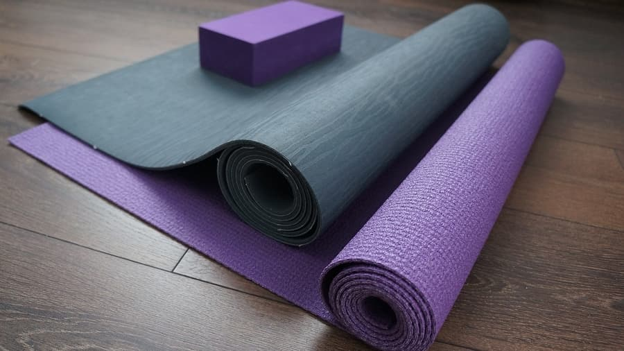 two yoga mats rolled up with a yoga block on top