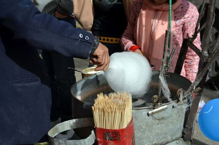 person making cotton candy