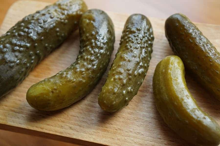 pickles on a wooden cutting board
